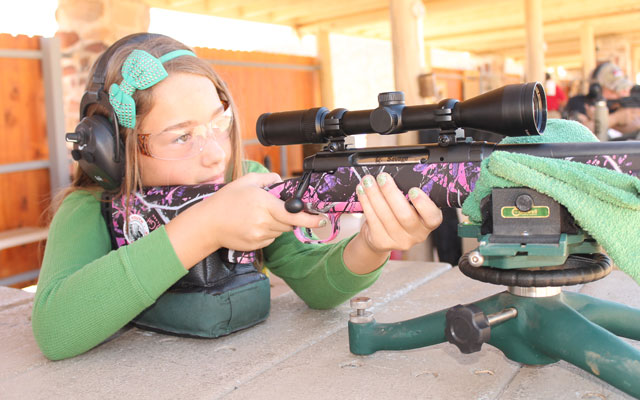 girl shooting savage deer rifle