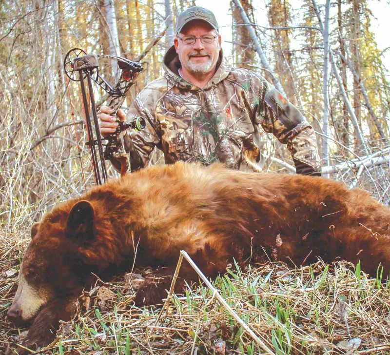 04232db68bc37 The author with his first cinnamon-colored black bear, which turned out to  be